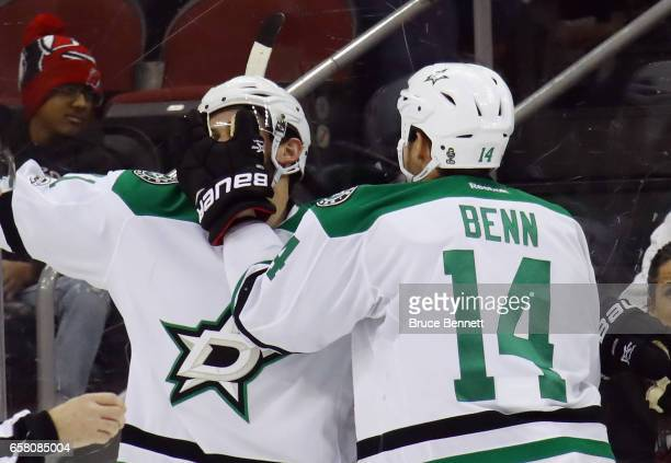 Tyler Seguin of the Dallas Stars scores at 20 seconds of overtime against the New Jersey Devils and is joined by Jamie Benn at the Prudential Center...