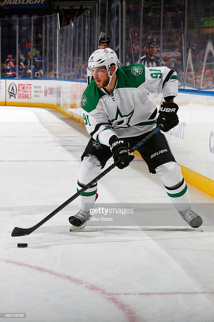 <a gi-track='captionPersonalityLinkClicked' href=/galleries/search?phrase=Tyler+Seguin&family=editorial&specificpeople=6698848 ng-click='$event.stopPropagation()'>Tyler Seguin</a> #91 of the Dallas Stars skates against the New York Islanders at Nassau Veterans Memorial Coliseum on October 25, 2014 in Uniondale, New York. The New York Islanders defeated the Dallas Stars 7-5.
