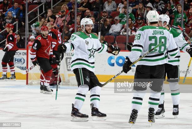Tyler Seguin of the Dallas Stars skates in to celebrate with teammates Stephen Johns and Alexander Radulov after Johns' third period goal against the...