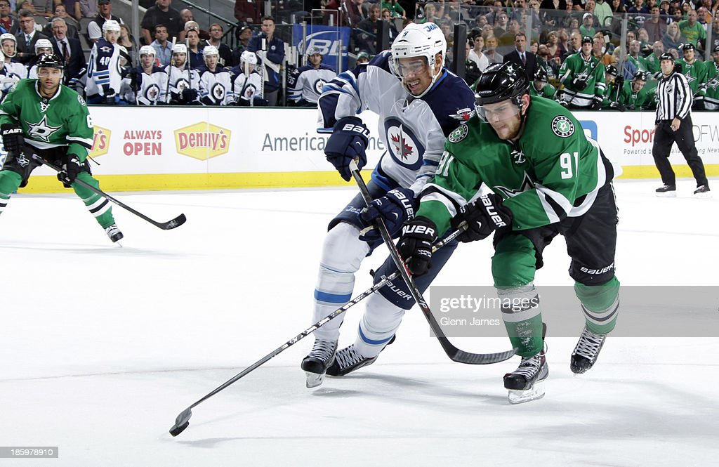 <a gi-track='captionPersonalityLinkClicked' href=/galleries/search?phrase=Tyler+Seguin&family=editorial&specificpeople=6698848 ng-click='$event.stopPropagation()'>Tyler Seguin</a> #91 of the Dallas Stars tries to keep the puck away against <a gi-track='captionPersonalityLinkClicked' href=/galleries/search?phrase=Evander+Kane&family=editorial&specificpeople=4303789 ng-click='$event.stopPropagation()'>Evander Kane</a> #9 of the Winnipeg Jets at the American Airlines Center on October 26, 2013 in Dallas, Texas.