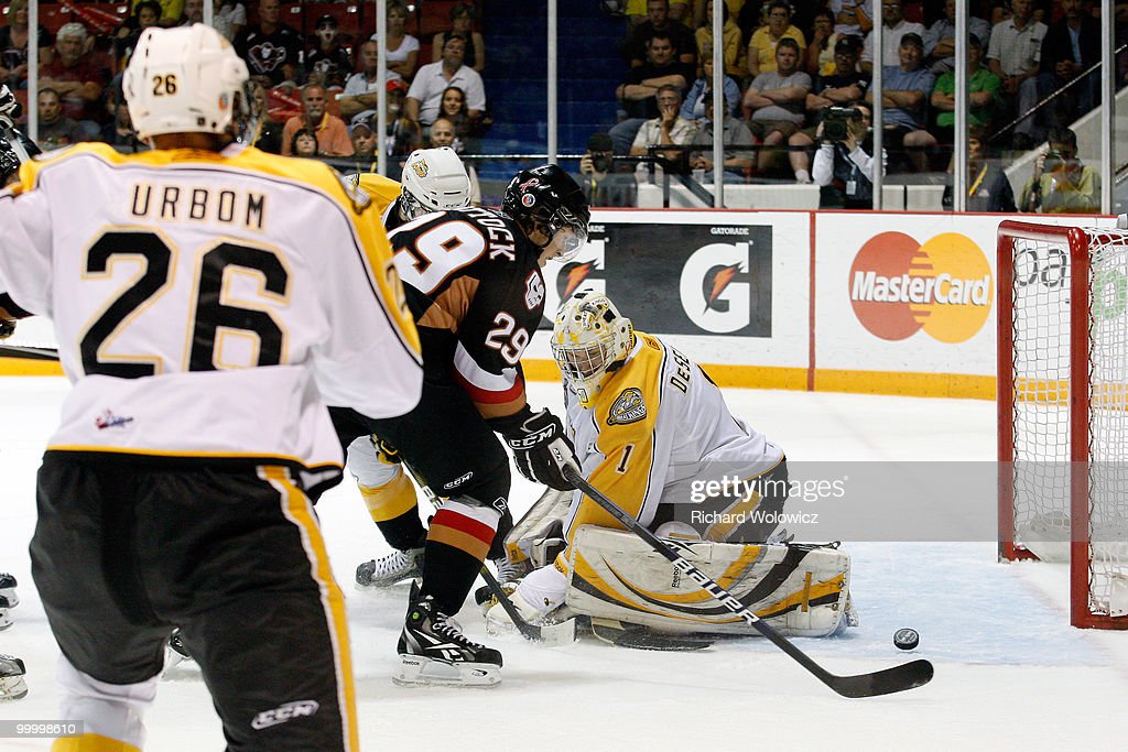 Tyler Shattock of the Calgary Hitmen scores a firstperiod goal on Jacob De Serres of the Brandon Wheat Kings during the 2010 Mastercard Memorial Cup...