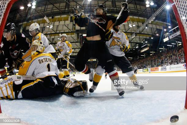 Tyler Shattock of the Calgary Hitmen scores a goal on Jacob De Serres of the Brandon Wheat Kings during the 2010 Mastercard Memorial Cup Tournament...