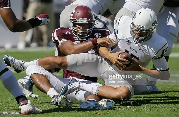 Tyler Stewart of the Nevada Wolf Pack is sacked by Myles Garrett of the Texas AM Aggies in the first quarter at Kyle Field on September 19 2015 in...
