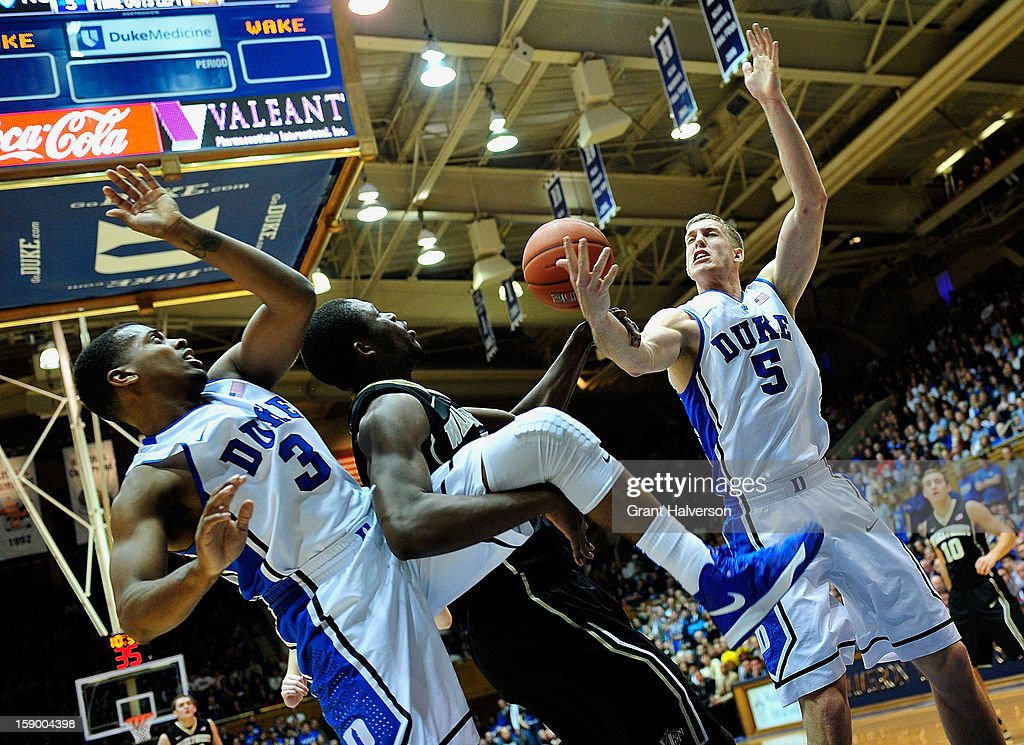 Tyler Thornton #3 and <a gi-track='captionPersonalityLinkClicked' href=/galleries/search?phrase=Mason+Plumlee&family=editorial&specificpeople=5792012 ng-click='$event.stopPropagation()'>Mason Plumlee</a> #5 of the Duke Blue Devils battle for a rebound with Amaud William Adala Moto #45 of the Wake Forest Demon Deacons during play at Cameron Indoor Stadium on January 5, 2013 in Durham, North Carolina.