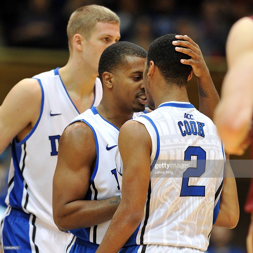 Tyler Thornton #3 and <a gi-track='captionPersonalityLinkClicked' href=/galleries/search?phrase=Quinn+Cook&family=editorial&specificpeople=6753591 ng-click='$event.stopPropagation()'>Quinn Cook</a> #2 of the Duke Blue Devils react following a play against the Elon Phoenix at Cameron Indoor Stadium on December 20, 2012 in Durham, North Carolina. Duke defeated Elon 76-54.