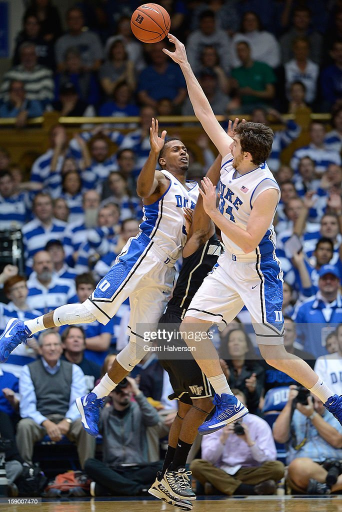 Tyler Thornton #3 and Ryan Kelly #34 of the Duke Blue Devils knock a long rebound away from Devin Thomas #2 of the Wake Forest Demon Deacons during play at Cameron Indoor Stadium on January 5, 2013 in Durham, North Carolina.