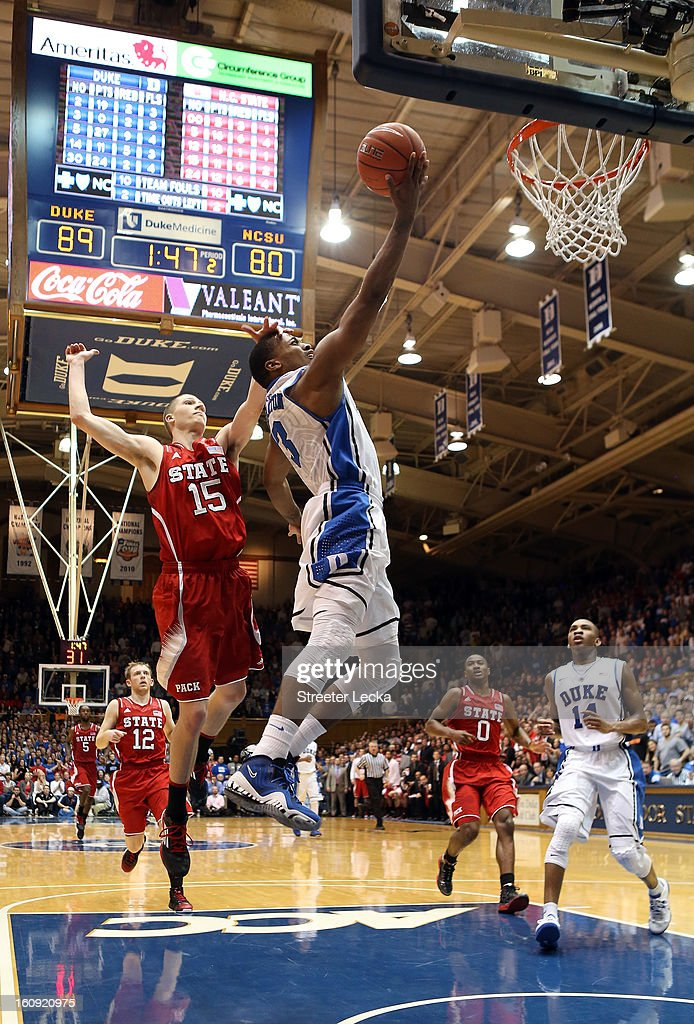 Tyler Thornton #3 of the Duke Blue Devils drives to the basket against Scott Wood #15 of the North Carolina State Wolfpack during their game at Cameron Indoor Stadium on February 7, 2013 in Durham, North Carolina.