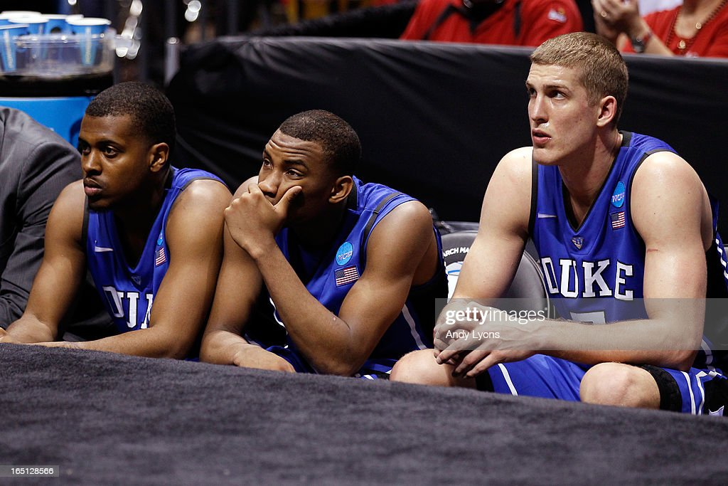 Tyler Thornton #3, Rasheed Sulaimon #14 and Mason Plumlee #5 of the Duke Blue Devils sit dejected on the bench in the final minute of their 85-63 loss to the Louisville Cardinals during the Midwest Regional Final round of the 2013 NCAA Men's Basketball Tournament at Lucas Oil Stadium on March 31, 2013 in Indianapolis, Indiana.