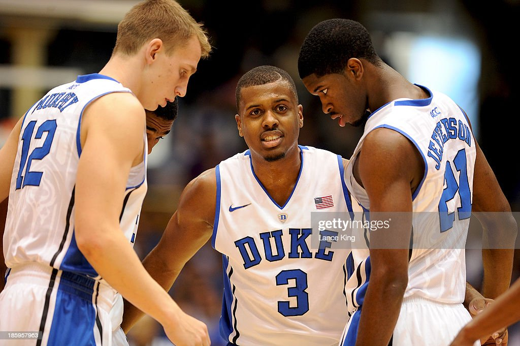 Tyler Thornton #3 talks with teammates Alex Murphy #12 and Amile Jefferson #21 of the Duke Blue Devils during a game against the Bowie State Bulldogs at Cameron Indoor Stadium on October 26, 2013 in Durham, North Carolina.