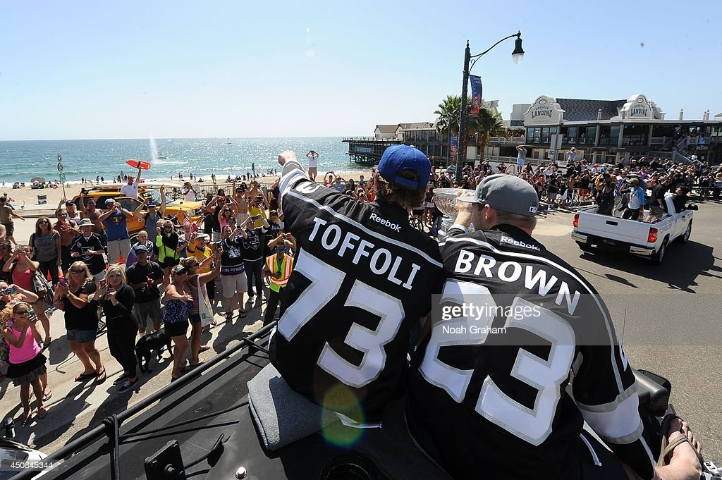 <a gi-track='captionPersonalityLinkClicked' href=/galleries/search?phrase=Tyler+Toffoli&family=editorial&specificpeople=6514151 ng-click='$event.stopPropagation()'>Tyler Toffoli</a> #73 and Dustin Brown #23 of the Los Angeles Kings wave to the crowd during the Los Angeles Kings South Bay Victory Parade on June 18, 2014 in Redondo Beach, California.