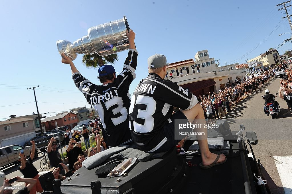 <a gi-track='captionPersonalityLinkClicked' href=/galleries/search?phrase=Tyler+Toffoli&family=editorial&specificpeople=6514151 ng-click='$event.stopPropagation()'>Tyler Toffoli</a> #73 hoists the Stanley Cup as Dustin Brown #23 of the Los Angeles Kings waves to the crowd during the Los Angeles Kings South Bay Victory Parade on June 18, 2014 in Redondo Beach, California.