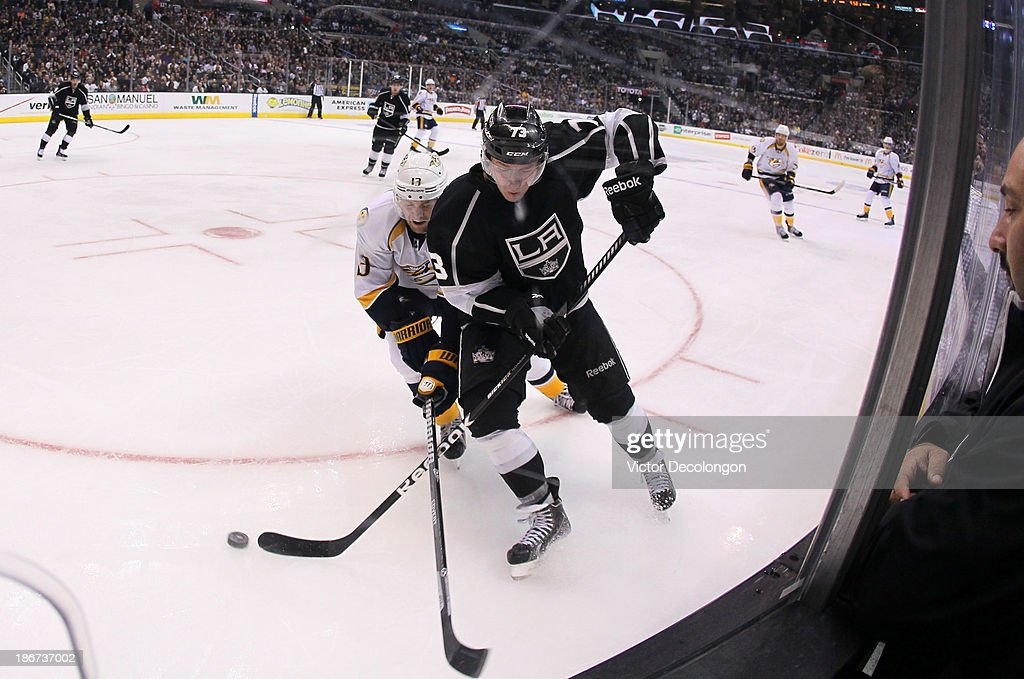 <a gi-track='captionPersonalityLinkClicked' href=/galleries/search?phrase=Tyler+Toffoli&family=editorial&specificpeople=6514151 ng-click='$event.stopPropagation()'>Tyler Toffoli</a> #73 of the Los Angeles Kings and <a gi-track='captionPersonalityLinkClicked' href=/galleries/search?phrase=Nick+Spaling&family=editorial&specificpeople=4112920 ng-click='$event.stopPropagation()'>Nick Spaling</a> #13 of the Nashville Predators vie for the puck in the corner during the NHL game at Staples Center on November 2, 2013 in Los Angeles, California. The Predators defeated the Kings 4-3.