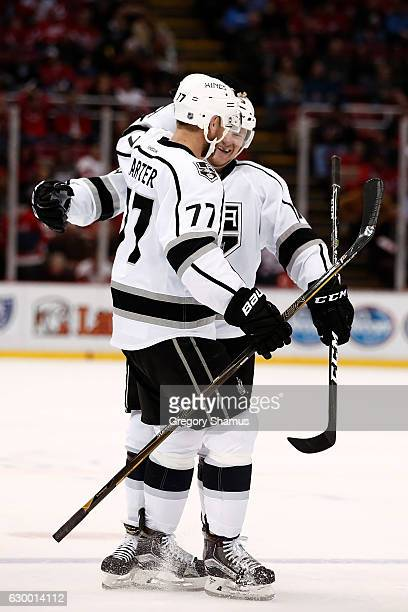Tyler Toffoli of the Los Angeles Kings celebrates a third period goal with Jeff Carter while playing the Detroit Red Wings at Joe Louis Arena on...