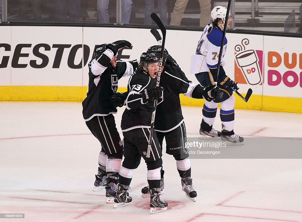 Tyler Toffoli #73 of the Los Angeles Kings celebrates with Drew Doughty #8 and Colin Fraser #24 after Doughty's goal in the first period as T.J. Oshie #74 of the St. Louis Blues looks on during Game Six of the Western Conference Quarterfinals during the 2013 NHL Stanley Cup Playoffs at Staples Center on May 10, 2013 in Los Angeles, California. The Kings defeated the Blues 2-1 to win the series 4 games to 2 to advance to the Western Conference Semifinals.