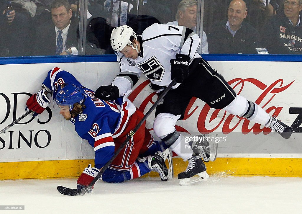 Tyler Toffoli #73 of the Los Angeles Kings checks Carl Hagelin #62 of the New York Rangers to the ice during the second period of Game Four of the 2014 NHL Stanley Cup Final at Madison Square Garden on June 11, 2014 in New York, New York.