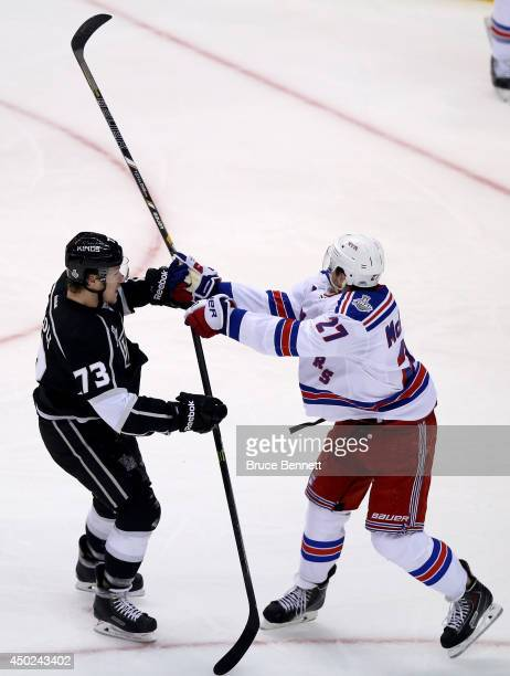 Tyler Toffoli of the Los Angeles Kings checks Ryan McDonagh of the New York Rangers in the first period during Game Two of the 2014 NHL Stanley Cup...