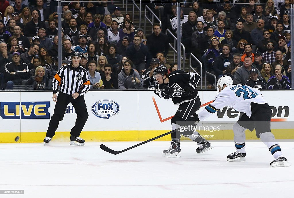 Tyler Toffoli of the Los Angeles Kings gets his shot off from the right wing before defenseman Dan Boyle of the San Jose Sharks can break up the play...