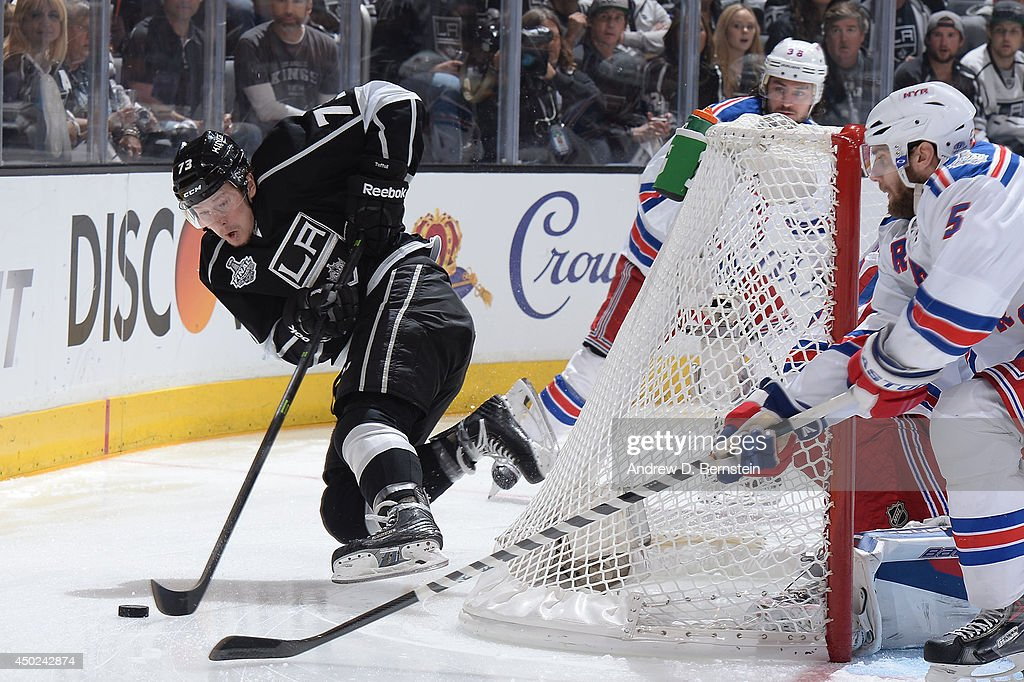 <a gi-track='captionPersonalityLinkClicked' href=/galleries/search?phrase=Tyler+Toffoli&family=editorial&specificpeople=6514151 ng-click='$event.stopPropagation()'>Tyler Toffoli</a> #73 of the Los Angeles Kings handles the puck behind the goal against the New York Rangers in the first period of Game Two of the Stanley Cup Final during the 2014 Stanley Cup Playoffs at Staples Center on June 7, 2014 in Los Angeles, California.