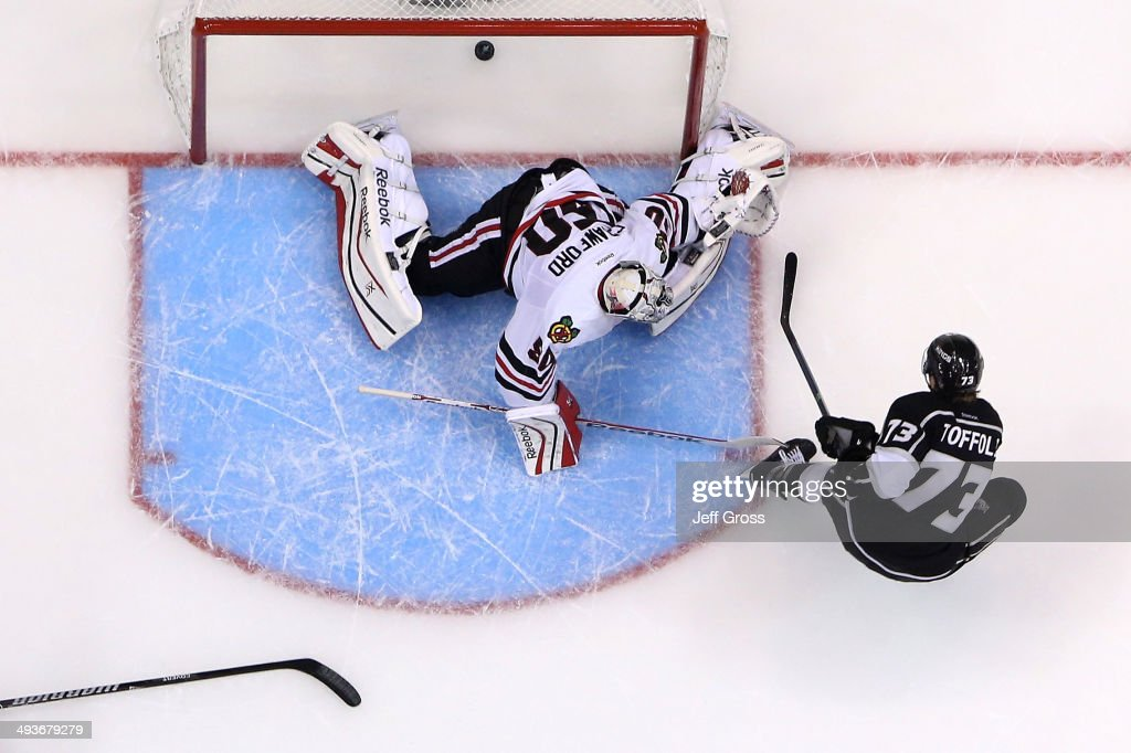 <a gi-track='captionPersonalityLinkClicked' href=/galleries/search?phrase=Tyler+Toffoli&family=editorial&specificpeople=6514151 ng-click='$event.stopPropagation()'>Tyler Toffoli</a> #73 of the Los Angeles Kings scores a second period goal past goaltender <a gi-track='captionPersonalityLinkClicked' href=/galleries/search?phrase=Corey+Crawford&family=editorial&specificpeople=818935 ng-click='$event.stopPropagation()'>Corey Crawford</a> #50 of the Chicago Blackhawks in Game Three of the Western Conference Final during the 2014 Stanley Cup Playoffs at Staples Center on May 24, 2014 in Los Angeles, California.