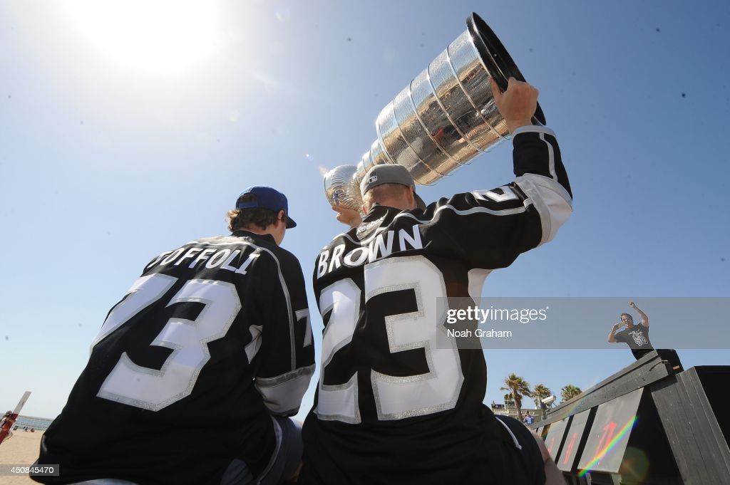 <a gi-track='captionPersonalityLinkClicked' href=/galleries/search?phrase=Tyler+Toffoli&family=editorial&specificpeople=6514151 ng-click='$event.stopPropagation()'>Tyler Toffoli</a> #73 waves to the crowd as Dustin Brown #23 of the Los Angeles Kings hoists the Stanley Cup up in the air during the Los Angeles Kings South Bay Victory Parade on June 18, 2014 in Redondo Beach, California.