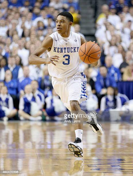 Tyler Ulis of the Kentucky Wildcats dribbles the ball during the game against the North Carolina Tar Heels at Rupp Arena on December 13 2014 in...