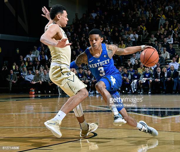 Tyler Ulis of the Kentucky Wildcats drives against Wade Baldwin IV of the Vanderbilt Commodores during the first half at Memorial Gym on February 27...