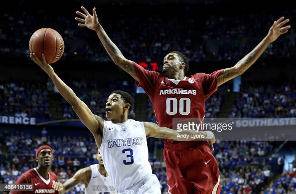 Tyler Ulis of the Kentucky Wildcats goes to the basket as Rashad Madden of the Arkansas Razorbacks defends during the championship game of the SEC...