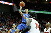Tyler Ulis of the Kentucky Wildcats shoots the ball during the game against the Louisville Cardinals at KFC YUM Center on December 27 2014 in...