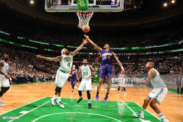 Tyler Ulis of the Phoenix Suns and Isaiah Thomas of the Boston Celtics jump for the rebound on March 24 2017 at the TD Garden in Boston Massachusetts...
