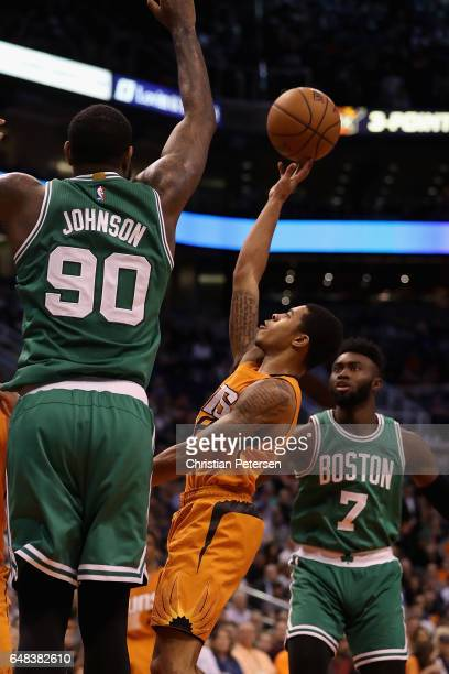 Tyler Ulis of the Phoenix Suns attempts a shot against Amir Johnson of the Boston Celtics during the first half of the NBA game at Talking Stick...