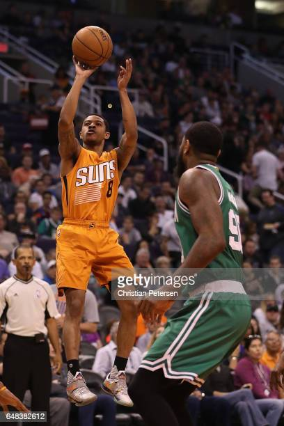 Tyler Ulis of the Phoenix Suns attempts a shot against the Boston Celtics during the first half of the NBA game at Talking Stick Resort Arena on...