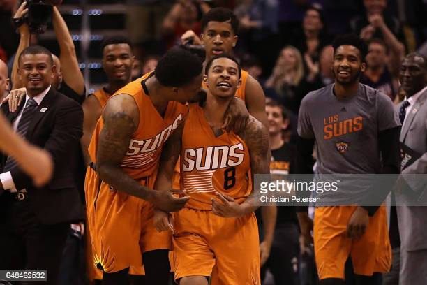 Tyler Ulis of the Phoenix Suns celebrates with Eric Bledsoe after hitting the game winning three point shot against the Boston Celtics in the NBA...