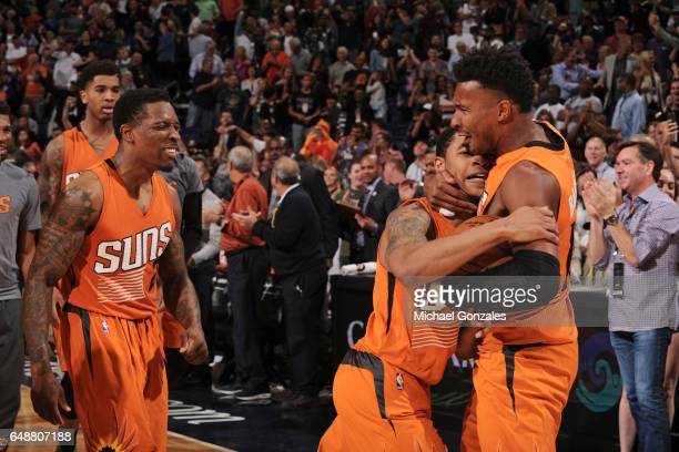 Tyler Ulis of the Phoenix Suns celebrates with Leandro Barbosa after the Suns defeat the Boston Celtics on March 5 2017 at US Airways Center in...