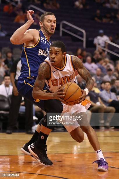 Tyler Ulis of the Phoenix Suns drives the ball past Adam Gibson of the Brisbane Bullets during the second half of the NBA preseason game at Talking...