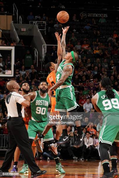 Tyler Ulis of the Phoenix Suns goes for the jump ball against Isaiah Thomas of the Boston Celtics during the game on March 5 2017 at US Airways...