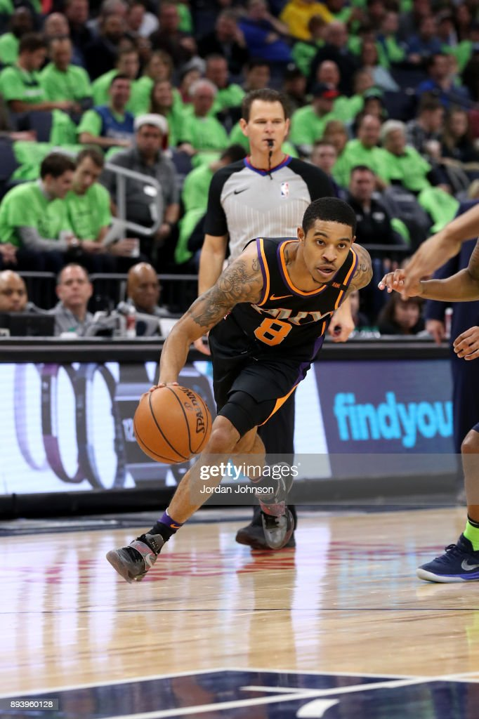 Tyler Ulis #8 of the Phoenix Suns handles the ball against the Minnesota Timberwolves on December 16, 2017 at Target Center in Minneapolis, Minnesota.