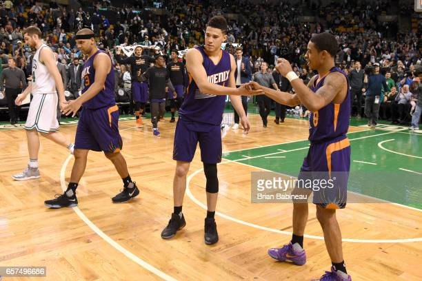Tyler Ulis of the Phoenix Suns highfives Devin Booker of the Phoenix Suns after scoring 70 points against the Boston Celtics on March 24 2017 at the...