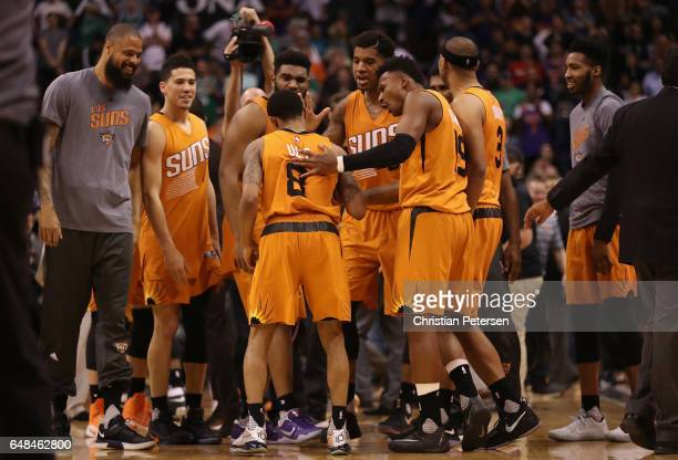 Tyler Ulis of the Phoenix Suns is congratulated by teammates Tyson Chandler Devin Booker Alan Williams Marquese Chriss Leandro Barbosa and Jared...