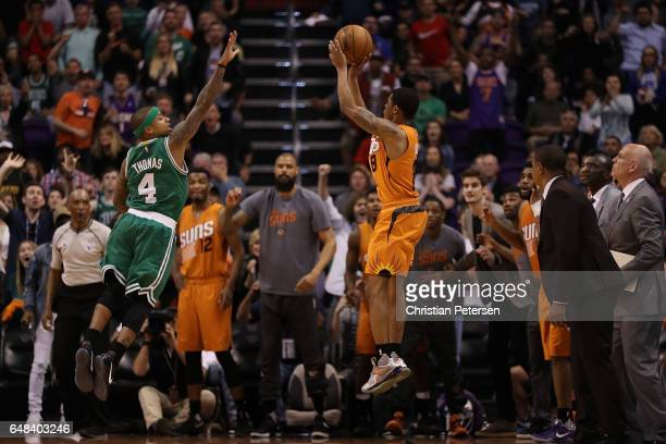Tyler Ulis of the Phoenix Suns puts up the game winning three point shot over Isaiah Thomas of the Boston Celtics during the final moments of the...