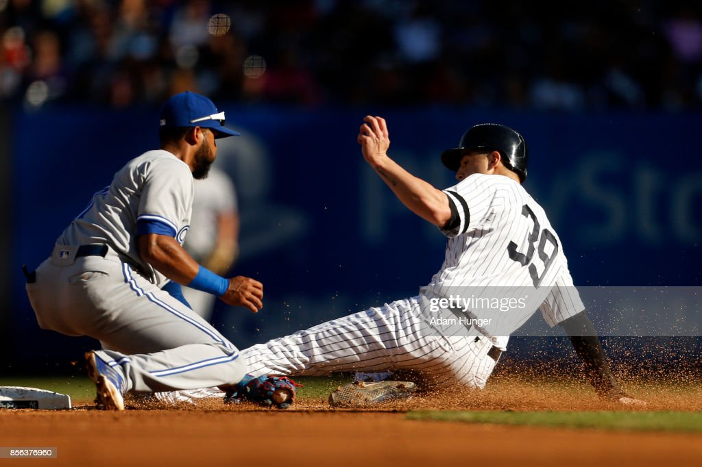Tyler Wade #39 of the New York Yankees is tagged out attempting to steal second base by Richard Urena #7 of the Toronto Blue Jays fourth inning at Yankee Stadium on October 1, 2017 in the Bronx borough of New York City.