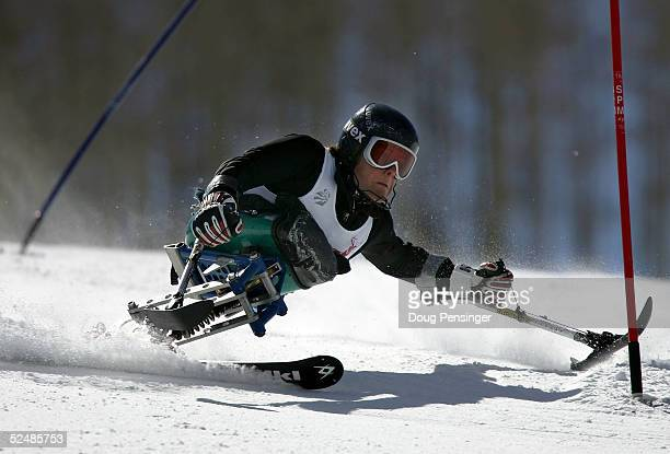 Tyler Walker attacks the Slalom course enroute to second place in the men's Sitting Skier Slalom race at the US Disabled Alpine Skiing Championships...