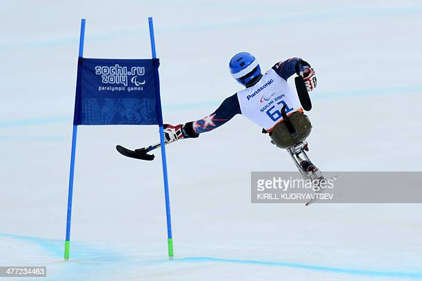 US Tyler Walker falls during Men's Downhill Sitting at XI Paralympic Olympic games in the Rosa Khutor stadium close to city of Sochi on March 8 2014...