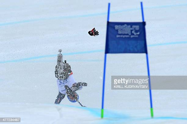 US Tyler Walker falls during Men's Downhill Sitting at XI Paralympic Olympic games in the Rosa Khutor stadium close to Sochi on March 8 2014 AFP...