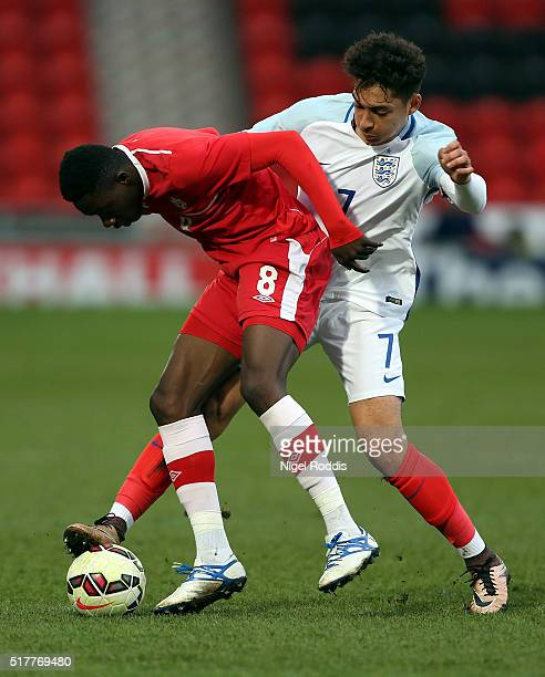 Tyler Walker of England challenges Alphonso Davies of Canada during the U20 International Friendly match between England and Canada at the Keepmoat...