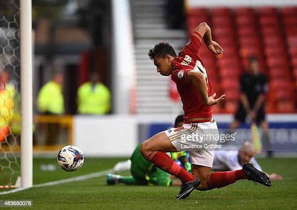 Tyler Walker of Nottingham Forest scores his sides first goal during the Capital One Cup First Round match between Nottingham Forest and Walsall at...