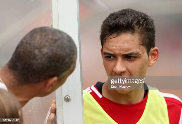 Tyler Walker of Nottingham Forest talks to Des Walker during a pre season friendly between Ilkeston and Nottingham Forest on July 12 2014 in Ilkeston...