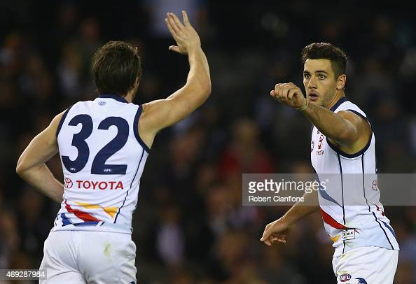 Tyler Walker of the Crows celebrates with Patrick Dangerfield after scoring a goal during the round two AFL match between the Collingwood Magpies and...