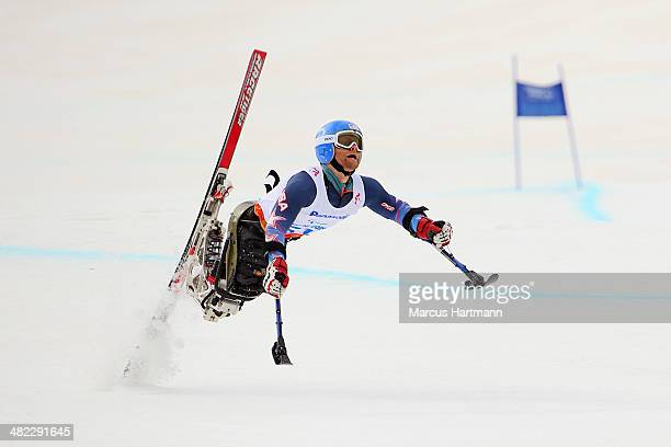 Tyler Walker of United States crashes in the Men's Downhill Sitting during day one of Sochi 2014 Paralympic Winter Games at Rosa Khutor Alpine Center...