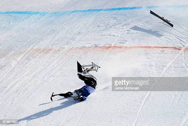 Tyler Walker of USA crashes as he competes in the Men's Sitting SuperG during Day 8 of the 2010 Vancouver Winter Paralympics at Whistler Creekside on...