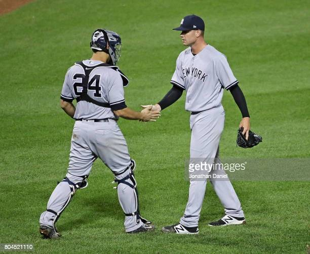 Tyler Webb of the New York Yankees shakes hands with Gary Sanchez after a win against the Chicago White Sox at Guaranteed Rate Field on June 28 2017...